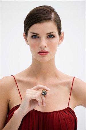 Fashion model smoking a cigar Stock Photo - Premium Royalty-Free, Code: 6108-05864321