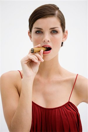 Fashion model smoking a cigar Stock Photo - Premium Royalty-Free, Code: 6108-05864326