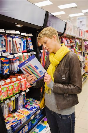 supply - Woman choosing stationery in a supermarket Stock Photo - Premium Royalty-Free, Code: 6108-05864560