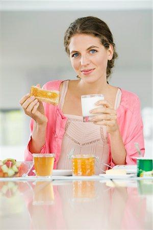 fat lady sitting - Portrait of a woman having breakfast Stock Photo - Premium Royalty-Free, Code: 6108-05864945