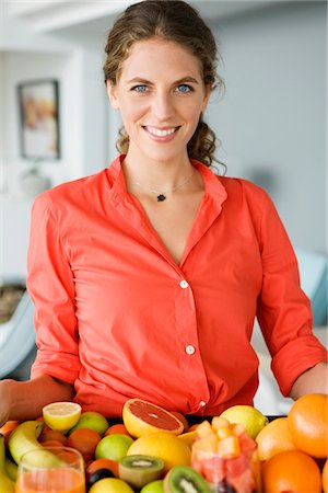 Portrait of a woman holding fruits Stock Photo - Premium Royalty-Free, Code: 6108-05864965