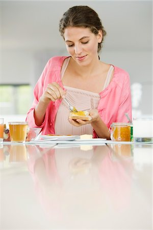 fat lady sitting - Woman spreading butter on a bread Stock Photo - Premium Royalty-Free, Code: 6108-05864970