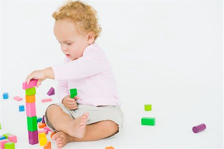 Baby boy playing with blocks Stock Photo - Premium Royalty-Free, Code: 6108-05865678