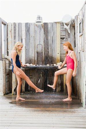 Two girls under a beach shower Stock Photo - Premium Royalty-Free, Code: 6108-05865948