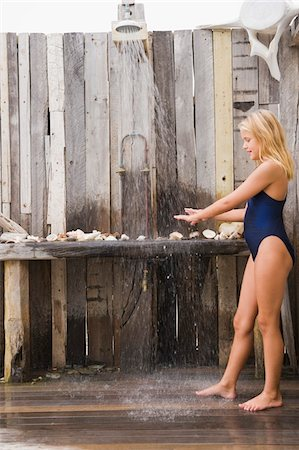 Girl under a beach shower Stock Photo - Premium Royalty-Free, Code: 6108-05865955