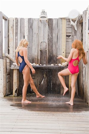 Two girls under a beach shower Stock Photo - Premium Royalty-Free, Code: 6108-05865900