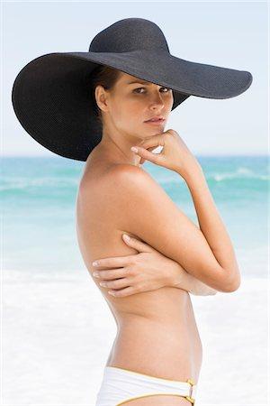 sexy black women in bikinis - Woman standing on the beach Stock Photo - Premium Royalty-Free, Code: 6108-05866551