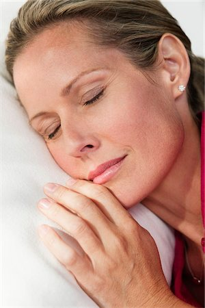 sleepy old woman - Close-up of a woman napping Stock Photo - Premium Royalty-Free, Code: 6108-05866648
