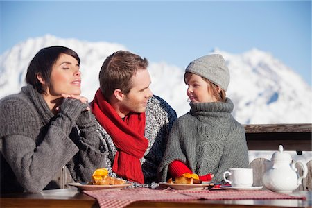 sweater - Couple and daughter eating on balcony at ski resort Stock Photo - Premium Royalty-Free, Code: 6108-05866794