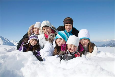 Happy family lying in snow Stock Photo - Premium Royalty-Free, Code: 6108-05867158