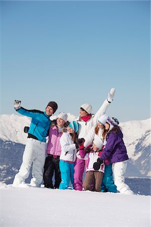 Family taking self portrait in snow Stock Photo - Premium Royalty-Free, Code: 6108-05867181