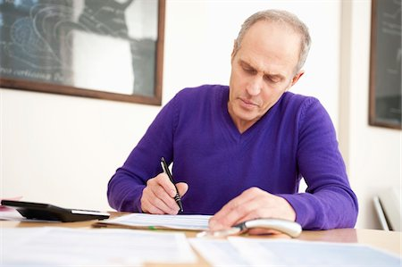 form - Man filling his tax form Stock Photo - Premium Royalty-Free, Code: 6108-05867364
