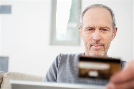 ebusiness - Man doing online shopping with a laptop Stock Photo - Premium Royalty-Free, Code: 6108-05867335