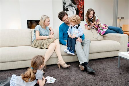 Family in a living room Stock Photo - Premium Royalty-Free, Code: 6108-05867684