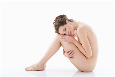 Portrait of a naked woman Stock Photo - Premium Royalty-Free, Code: 6108-05867793