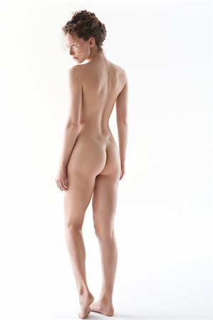 Rear view of a naked woman Stock Photo - Premium Royalty-Free, Code: 6108-05867795