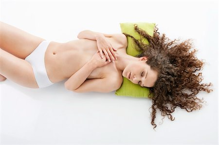 Woman covering her breasts and sleeping Stock Photo - Premium Royalty-Free, Code: 6108-05867738
