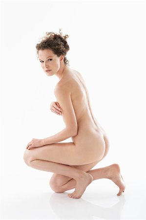 Naked woman covering her breasts Stock Photo - Premium Royalty-Free, Code: 6108-05867841