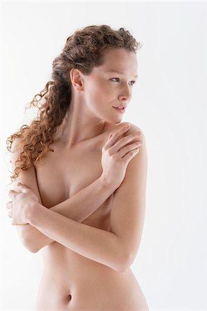 Naked woman hugging herself Stock Photo - Premium Royalty-Free, Code: 6108-05867842