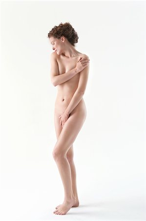 Naked woman covering groin with hand Stock Photo - Premium Royalty-Free, Code: 6108-05867800