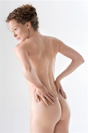 Rear view of a naked woman Stock Photo - Premium Royalty-Free, Code: 6108-05867801