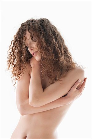 female nud - Woman covering her breasts Stock Photo - Premium Royalty-Free, Code: 6108-05867816