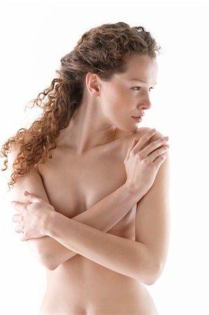 Naked woman hugging herself Stock Photo - Premium Royalty-Free, Code: 6108-05867818