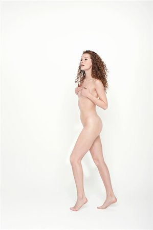 Naked woman covering her breasts Stock Photo - Premium Royalty-Free, Code: 6108-05867819