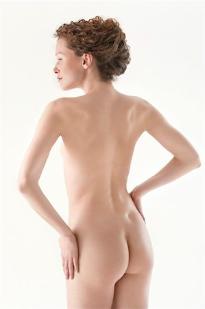 Rear view of a naked woman Stock Photo - Premium Royalty-Free, Code: 6108-05867822