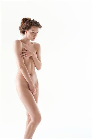 Naked woman covering groin with hand Stock Photo - Premium Royalty-Free, Code: 6108-05867827