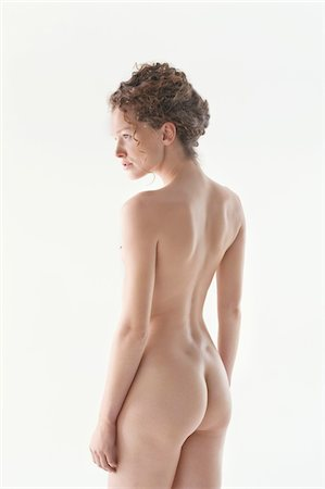 Rear view of a naked woman Stock Photo - Premium Royalty-Free, Code: 6108-05867825