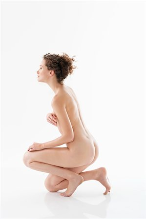 Naked woman covering her breasts Stock Photo - Premium Royalty-Free, Code: 6108-05867829