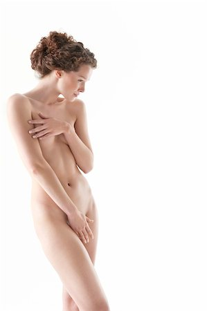 Naked woman covering groin with hand Stock Photo - Premium Royalty-Free, Code: 6108-05867836