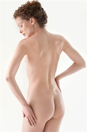 Rear view of a naked woman Stock Photo - Premium Royalty-Free, Code: 6108-05867839