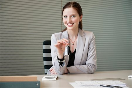 form - Female financial advisor holding a car key in an office Stock Photo - Premium Royalty-Free, Code: 6108-05868666