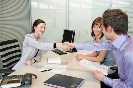 form - Female real estate agent shaking hands with a couple Stock Photo - Premium Royalty-Free, Code: 6108-05868615
