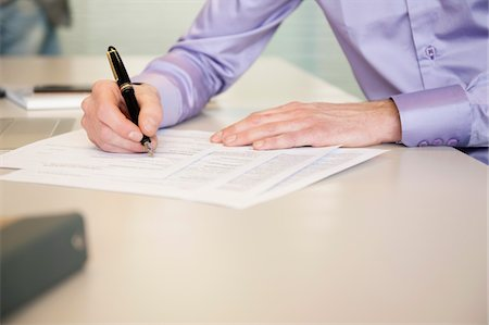 form - Man signing documents Stock Photo - Premium Royalty-Free, Code: 6108-05868638