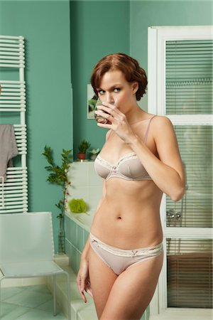 drinking water glass - Young woman in underwear drinking glass of water Stock Photo - Premium Royalty-Free, Code: 6108-05869090