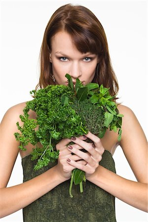 smelly - Young woman holding fresh herbs Stock Photo - Premium Royalty-Free, Code: 6108-05869138