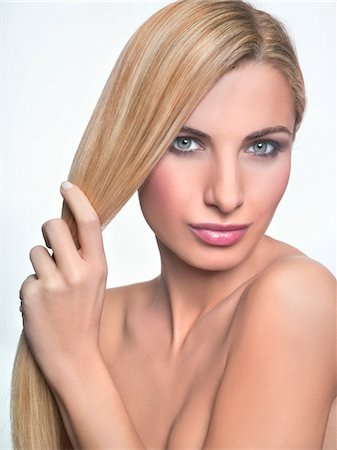 female nud - Young woman holding her hair Stock Photo - Premium Royalty-Free, Code: 6108-05869271