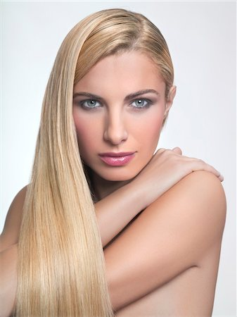 Portrait of young blond woman Stock Photo - Premium Royalty-Free, Code: 6108-05869280