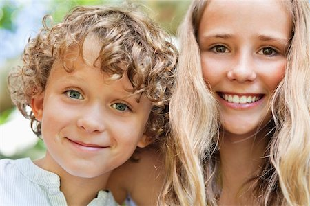 preteen girls faces photo - Close-up of smiling brother and his sister Stock Photo - Premium Royalty-Free, Code: 6108-05869491