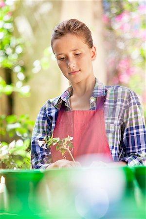 Girl gardening and thinking Stock Photo - Premium Royalty-Free, Code: 6108-05869494