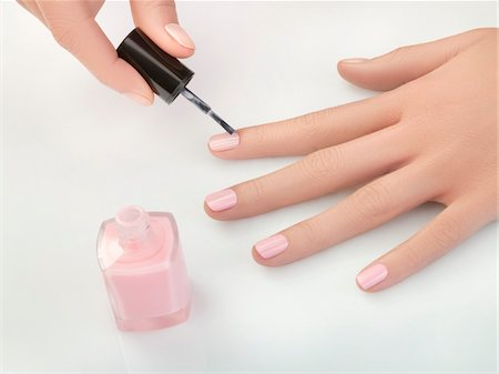 finger painting - Woman painting fingernails, close-up Stock Photo - Premium Royalty-Free, Code: 6108-05869421