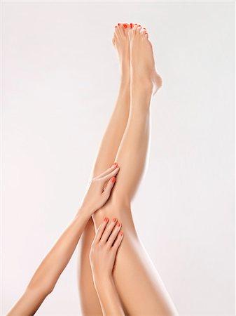 foot massage - Woman touching her legs Stock Photo - Premium Royalty-Free, Code: 6108-05869422