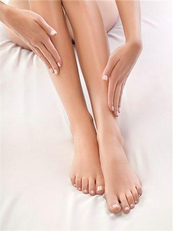 foot massage - Woman touching her legs Stock Photo - Premium Royalty-Free, Code: 6108-05869426