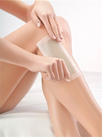 Woman waxing her leg Stock Photo - Premium Royalty-Free, Code: 6108-05869428