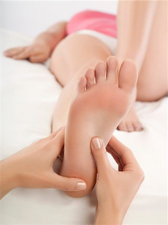 foot massage - Woman receiving foot massage Stock Photo - Premium Royalty-Free, Code: 6108-05869436