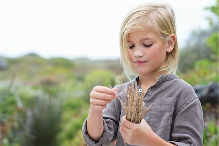 stick - Close-up of a girl holding wooden sticks Stock Photo - Premium Royalty-Free, Code: 6108-05869697