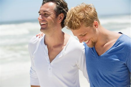 Two men laughing together Stock Photo - Premium Royalty-Free, Code: 6108-05869638